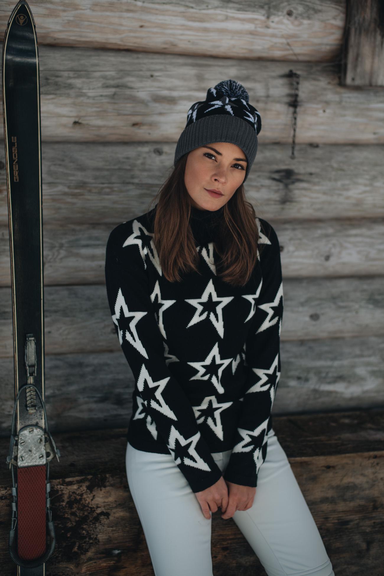 ski-bekleidung-skikleidung-modisch-damen-perfect-moment-wool-ski-sweater-Sternen-pullover-winter-fotoshooting-schnee-nina-schwichtenberg-fashionbloggerin-deutschland-münchen-fashiioncarpet